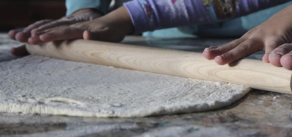rolling pizza dough