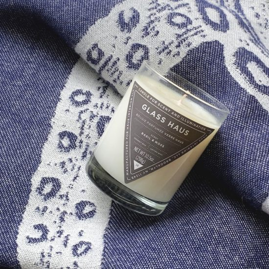 Navy Blue Alpaca Throw with Octopus Print by Thomas Paul and Glass Haus Coconut Wax Candle from Haus Interior